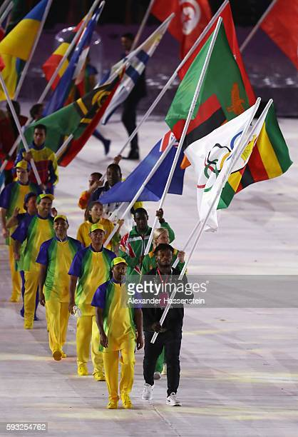 Flag bearer Popole Misenga of the Refugee Olympic Team parades in the 'Heroes of the Games' segment during the Closing Ceremony on Day 16 of the Rio...