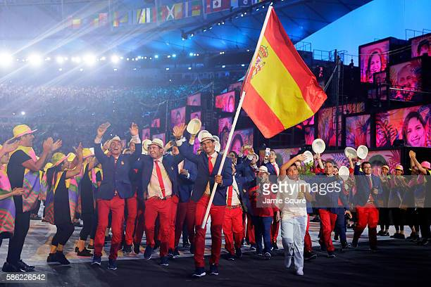 Flag bearer Rafael Nadal of Spain leads his team during the Opening Ceremony of the Rio 2016 Olympic Games at Maracana Stadium on August 5 2016 in...
