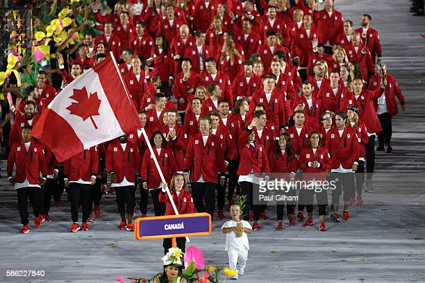 Flag bearer Rosannagh Maclennan of Canada leads her team during the Opening Ceremony of the Rio 2016 Olympic Games at Maracana Stadium on August 5,...