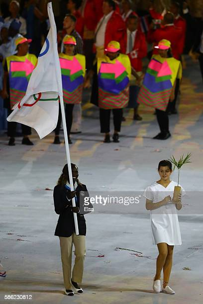Flag bearer Rose Lokonyen Nathike of the Refugee Olympic Team leads her team during the Opening Ceremony of the Rio 2016 Olympic Games at Maracana...