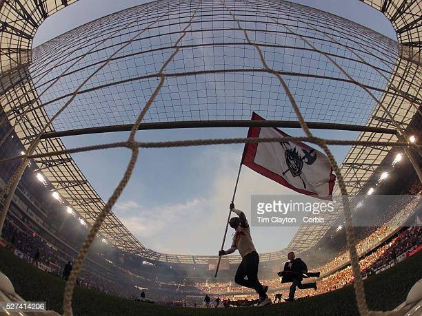 A flag bearer runs past the goalmouth during pre game presentations before the New York Red Bulls Vs New England Revolution MLS Eastern Conference...