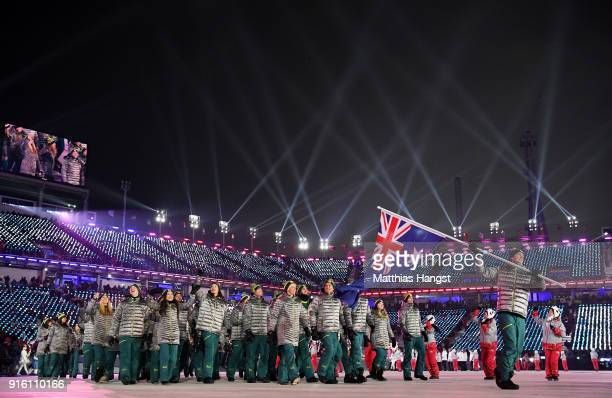 Flag bearer Scotty James of Australia and teammates enter the stadium during the Opening Ceremony of the PyeongChang 2018 Winter Olympic Games at...