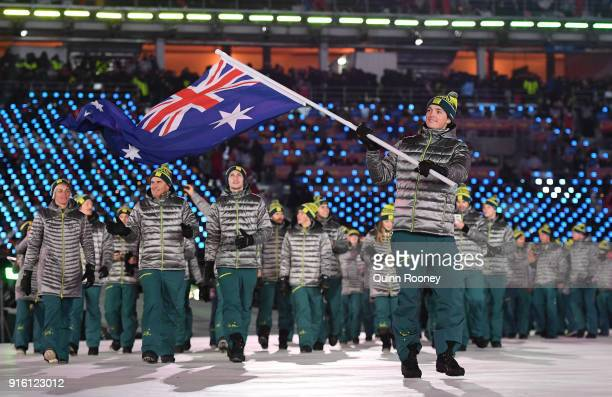 Flag bearer Scotty James of Australia leads his country out during the Opening Ceremony of the PyeongChang 2018 Winter Olympic Games at PyeongChang...