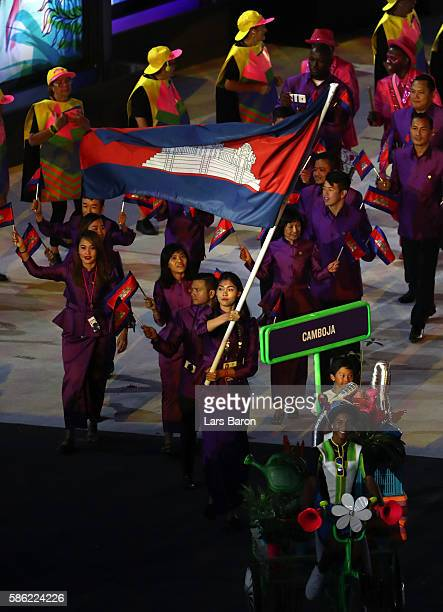 Flag bearer Seavmey Sorn of Cambodia leads the team members entering the stadium during the Opening Ceremony of the Rio 2016 Olympic Games at...