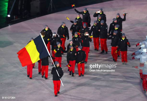 Flag bearer Seppe Smits of Belgium and teammates enter the stadium during the Opening Ceremony of the PyeongChang 2018 Winter Olympic Games at...