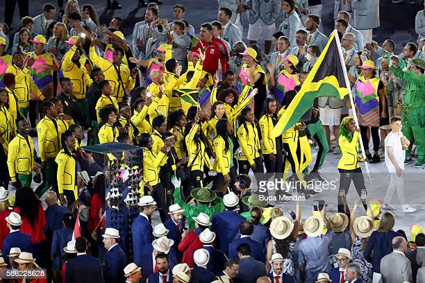 Flag bearer ShellyAnn FraserPryce of Jamaica leads her Olympic Team during the Opening Ceremony of the Rio 2016 Olympic Games at Maracana Stadium on...