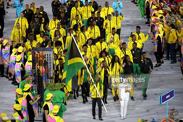 Flag bearer ShellyAnn FraserPryce of Jamaica leads her team during the Opening Ceremony of the Rio 2016 Olympic Games at Maracana Stadium on August 5...