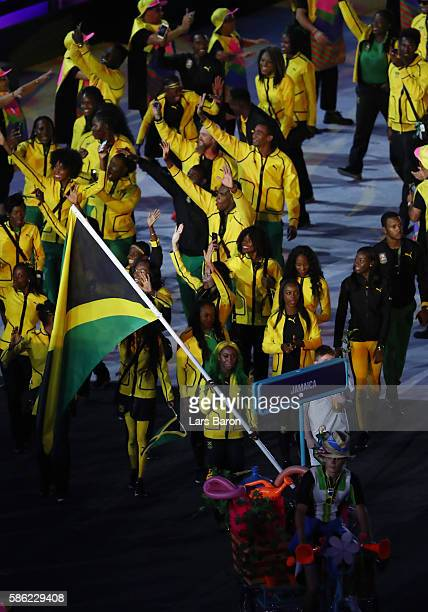Flag bearer ShellyAnn FraserPryce of Jamaica leads the team entering the stadium during the Opening Ceremony of the Rio 2016 Olympic Games at...
