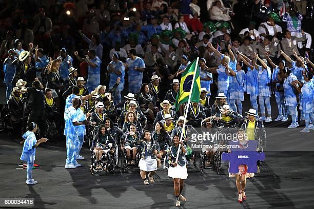 Flag bearer Shirlene Coelho leads Team Brazil during the Opening Ceremony of the Rio 2016 Paralympic Games at Maracana Stadium on September 7, 2016...