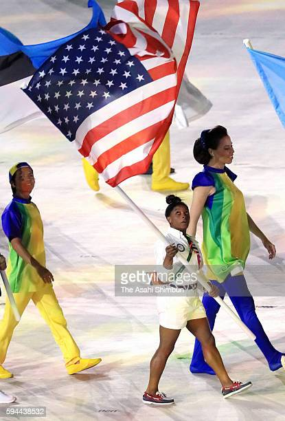 Flag bearer Simone Biles of United States marches on during the 'Heroes of the Games' segment during the Closing Ceremony on Day 16 of the Rio 2016...