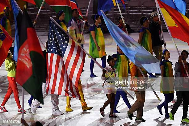 Flag bearer Simone Biles of United States parades in the 'Heroes of the Games' segment during the Closing Ceremony on Day 16 of the Rio 2016 Olympic...