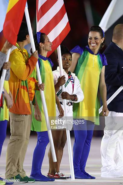 Flag bearer Simone Biles of United States takes part in the 'Heroes of the Games' segment during the Closing Ceremony on Day 16 of the Rio 2016...
