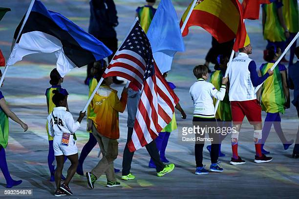 Flag bearer Simone Biles of United States walks during the Heroes of the Games segment during the Closing Ceremony on Day 16 of the Rio 2016 Olympic...