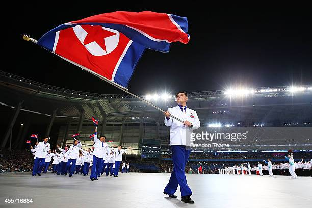Flag bearer, Sok Yongbom of North Korea arrives during the Opening Ceremony ahead of the 2014 Asian Games at Incheon Asiad Main Stadium on September...