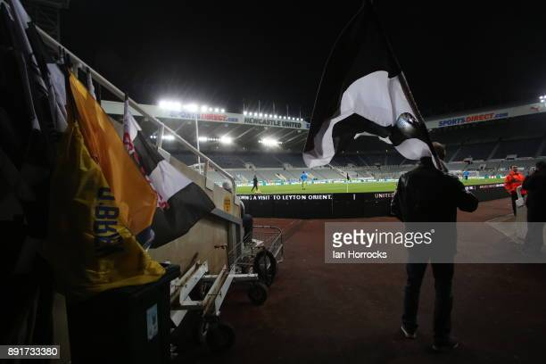 A flag bearer takes up position before the Premier League match between Newcastle United and Everton at St James' Park on December 13 2017 in...