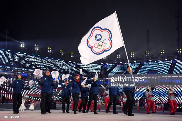 Flag bearer TeAn Lien of Chinese Taipei and teammates enter the stadium during the Opening Ceremony of the PyeongChang 2018 Winter Olympic Games at...