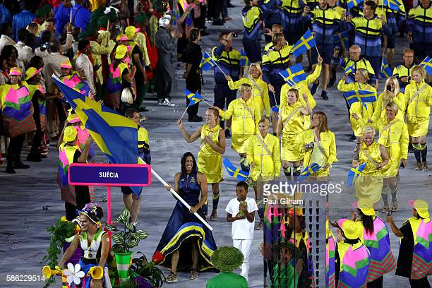 Flag bearer Therese Alshammar of Sweden leads her team during the Opening Ceremony of the Rio 2016 Olympic Games at Maracana Stadium on August 5 2016...