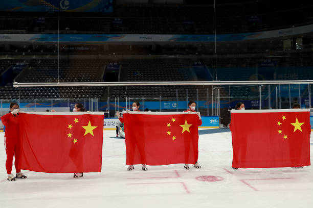 Flag bearer tidying up the national flag at the award ceremony during a Para Ice Hockey test event for the Beijing 2022 Winter Olympics at National...