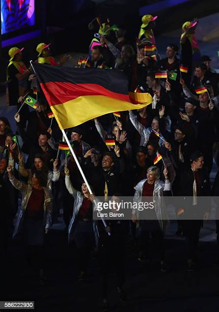 Flag bearer Timo Boll of Germany leads the Germany team during the Opening Ceremony of the Rio 2016 Olympic Games at Maracana Stadium on August 5...