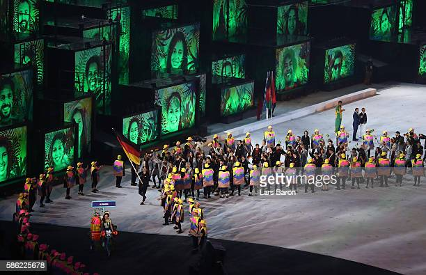 Flag bearer Timo Boll of Germany leads the team entering the stadium during the Opening Ceremony of the Rio 2016 Olympic Games at Maracana Stadium on...