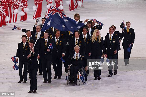 Flag bearer Toby Kane of Australia leads his team through the stadium during the Opening Ceremony of the 2010 Vancouver Winter Paralympic Games at BC...