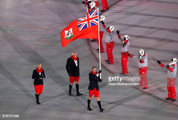 Flag bearer Tucker Murphy of Bermuda and teammates enter the stadium during the Opening Ceremony of the PyeongChang 2018 Winter Olympic Games at...