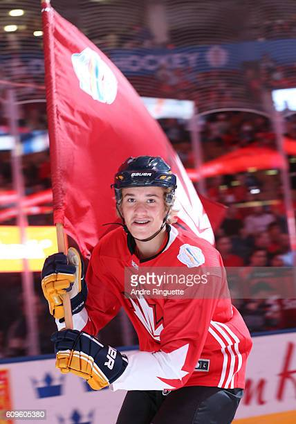 Flag bearer welcomes Team Canada prior to the game against Team Europe during the World Cup of Hockey 2016 at Air Canada Centre on September 21, 2016...