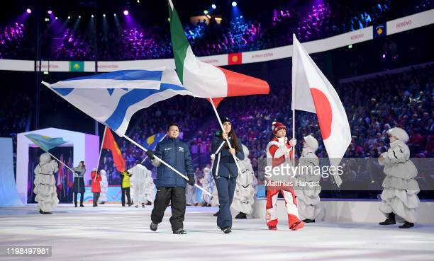 Flag bearer Yuma Kagiyama of Japan waves the flag during the Opening Ceremony of the Lausanne 2020 Winter Youth Olympic Games at Vaudoise Arena on...