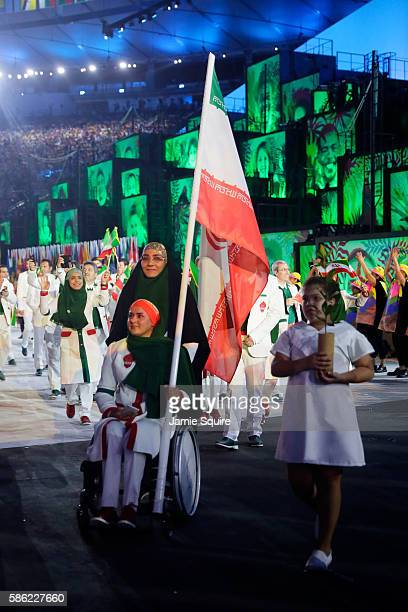 Flag bearer Zahra Nemati of Islamic Republic of Iran leads her team during the Opening Ceremony of the Rio 2016 Olympic Games at Maracana Stadium on...