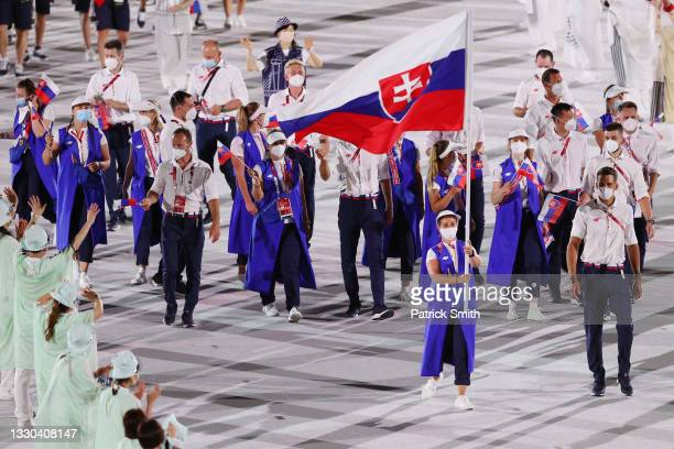 Flag bearer Zuzana Rehak Stefecekova of Team Slovakia carries the flag during the Opening Ceremony of the Tokyo 2020 Olympic Games at Olympic Stadium...