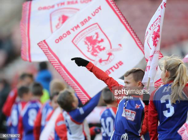 Flag bearers ahead of The Emirates FA Cup Third Round match between Middlesbrough and Sunderland at the Riverside Stadium on January 6 2018 in...