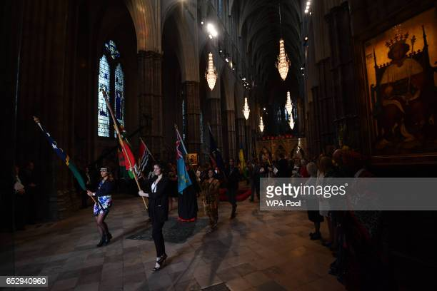 Flag bearers attend a Commonwealth Day Service at Westminster Abbey on March 13 2017 in London United Kingdom