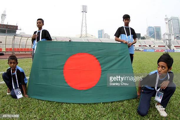 Flag bearers carry the Bangladesh National flag poses during a rehersal prior to the start of the 2018 FIFA World Cup Qualification match between...
