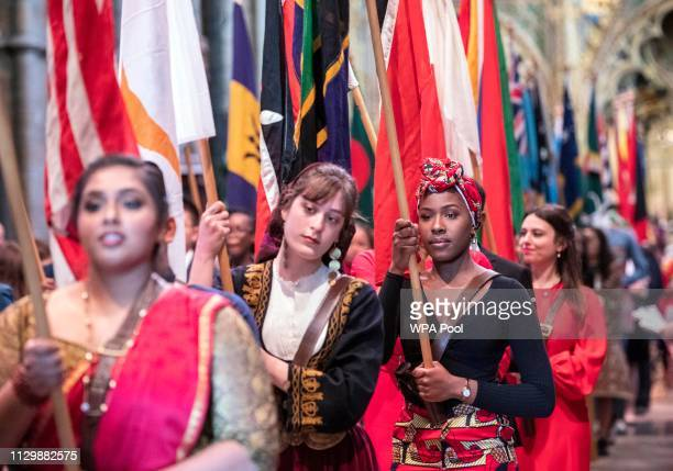 Flag bearers carrying the flags of the Commonwealth walk through Westminster Abbey during the Commonwealth day service on March 11 2019 in London...