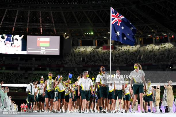 Flag bearers Cate Campbell and Patty Mills of Team Australia lead their team out during the Opening Ceremony of the Tokyo 2020 Olympic Games at...