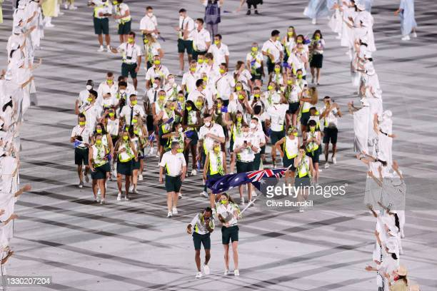 Flag bearers Cate Campbell and Patty Mills of Team Australia lead their team during the Opening Ceremony of the Tokyo 2020 Olympic Games at Olympic...