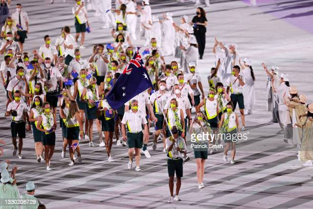 Flag bearers Cate Campbell and Patty Mills of Team Australia lead their team in during the Opening Ceremony of the Tokyo 2020 Olympic Games at...