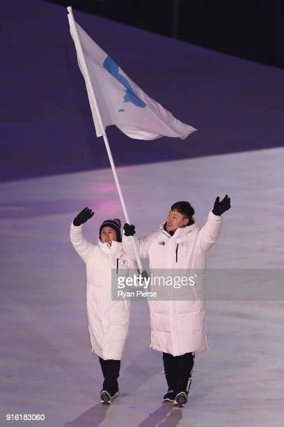Flag bearers Chung Guam Hwang and Yunjong Won of Republic of Korea leads the team during the Opening Ceremony of the PyeongChang 2018 Winter Olympic...