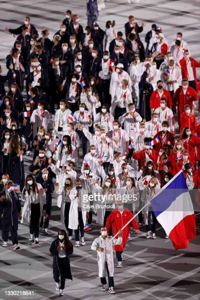Flag bearers Clarisse Agbegnenou and Samir Ait Said of Team France lead their team during the Opening Ceremony of the Tokyo 2020 Olympic Games at...