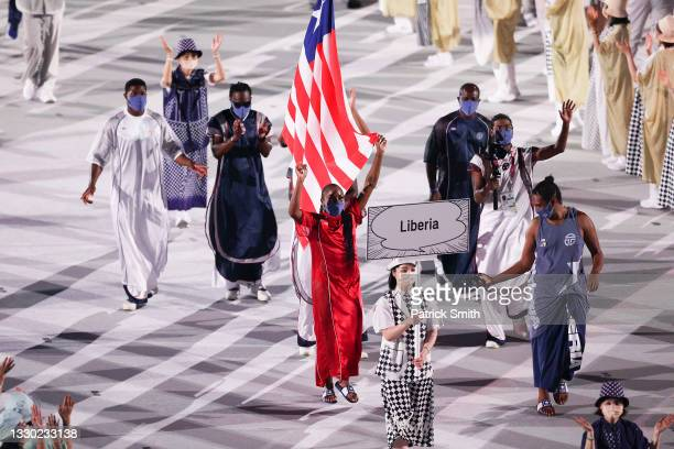Flag bearers Ebony Morrison and Joseph Fahnbulleh of Team Liberia during the Opening Ceremony of the Tokyo 2020 Olympic Games at Olympic Stadium on...