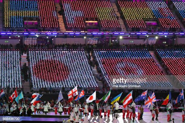 Flag bearers enter the stadium during the closing ceremony of the PyeongChang 2018 Paralympic Games at the PyeongChang Olympic Stadium on March 18...