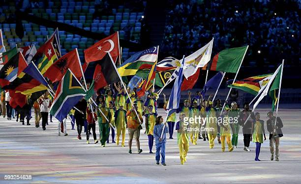Flag bearers enter the stadium during the Closing Ceremony on Day 16 of the Rio 2016 Olympic Games at Maracana Stadium on August 21, 2016 in Rio de...