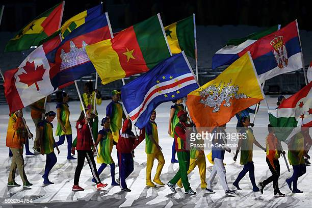 Flag bearers enter the stadium during the 'Heroes of the Games' segment during the Closing Ceremony on Day 16 of the Rio 2016 Olympic Games at...