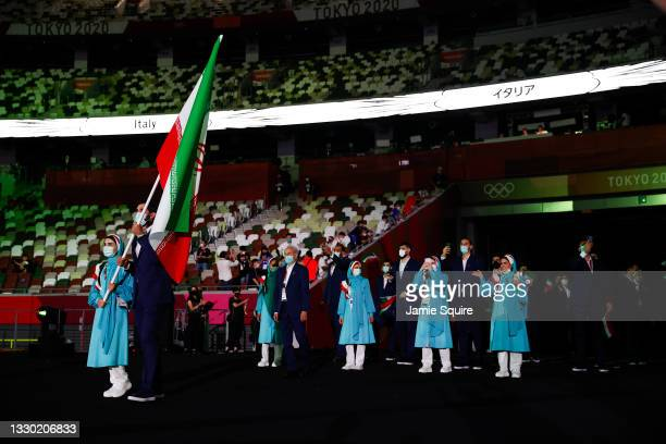 Flag bearers Haniyeh Rostamiyan and Mohammadsamad Nik Khahbahrami of Team Iran during the Opening Ceremony of the Tokyo 2020 Olympic Games at Olympic...
