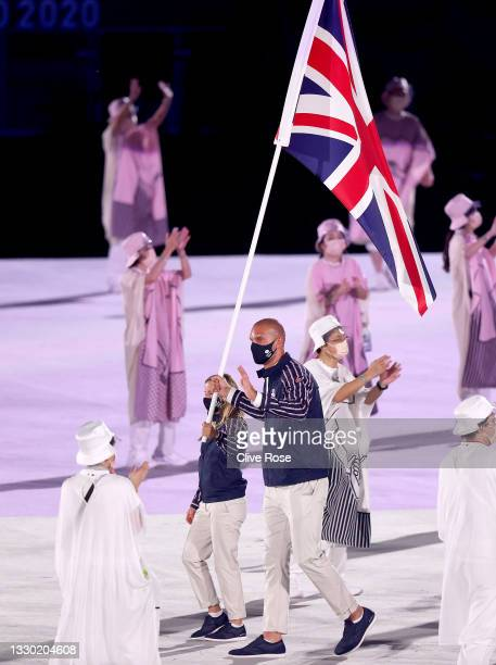 Flag bearers Hannah Mills and Mohamed Sbihi of Team Great Britain leads their team out during the Opening Ceremony of the Tokyo 2020 Olympic Games at...