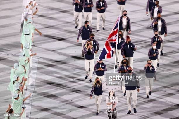 Flag bearers Hannah Mills and Mohamed Sbihi of Team Great Britain lead their team out during the Opening Ceremony of the Tokyo 2020 Olympic Games at...