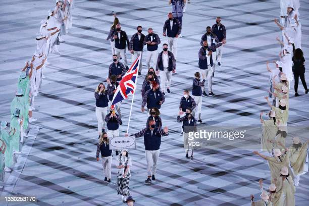 Flag bearers Hannah Mills and Mohamed Sbihi of Team Great Britain take part in the Parade of Nations during the Opening Ceremony of the Tokyo 2020...