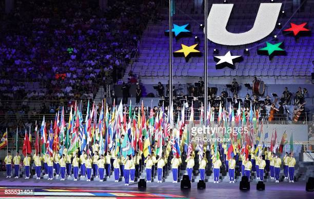 Flag bearers hold national flags during the opening ceremony of the 29th Summer Universiade Games at Taipei Municipal Stadium in Taipei on August 19...