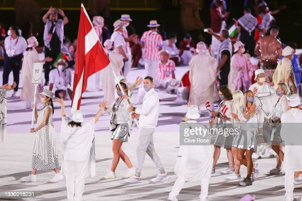 Flag bearers Jelena Ostapenko and Agnis Cavars of Team Latvia during the Opening Ceremony of the Tokyo 2020 Olympic Games at Olympic Stadium on July...