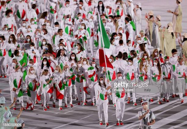 Flag bearers Jessica Rossi and Elia Viviani of Team Italy lead their team in during the Opening Ceremony of the Tokyo 2020 Olympic Games at Olympic...